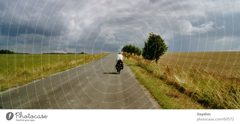 biker Field Clouds Bicycle Vacation & Travel Driving In transit Mobility Kick about Lanes & trails Sky Trip Mountain Nature