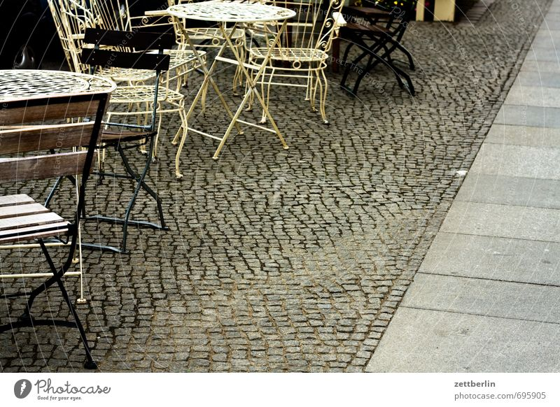 season start Chair Table Furniture Café Coffee To have a coffee Seating Sit Sidewalk café Footpath Paving stone Cobblestones Pavement Deserted Copy Space