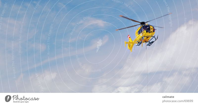 - Rescue flight - Helicopter Helper Hover Yellow rescue helicopter Sky rescue flight Search rescue rope Flying Eurocopter ec135