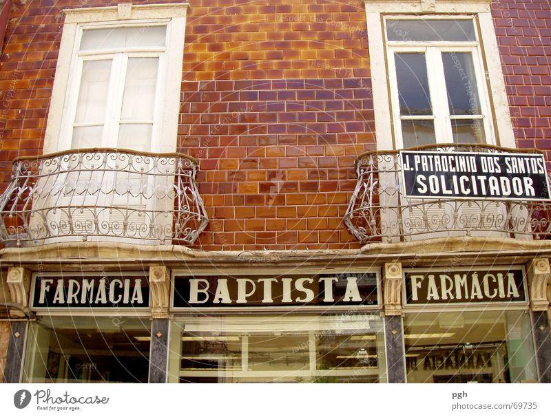 Baptista in Faro Portugal Balcony Handrail Window White Brick Brown Store premises Old town farmacia bapista