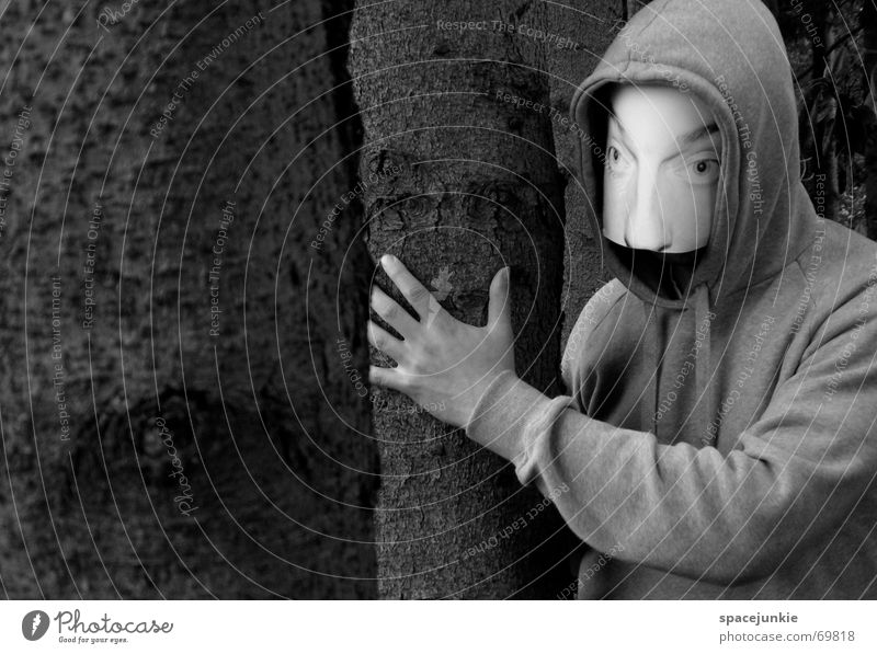 the man behind the mask Man Threat Eerie Forest Tree Ambush Mask Human being Face Hide Hiding place Behind