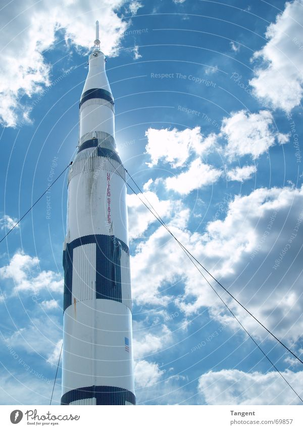 countdown USA Safety (feeling of) Countdown Clouds Light rocket missile Beginning launch Sky Blue Sun Universe space