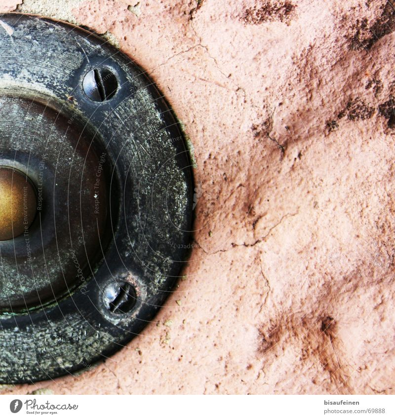 Caught in the rock Buttons Wall (barrier) Brass Sandstone Bell Partially visible Screw Stone Rock