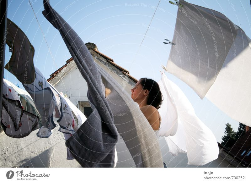 hardworking as ever Lifestyle Living or residing Attic Woman Adults Upper body 1 Human being 30 - 45 years Beautiful weather Wind Clothesline Washing Laundry
