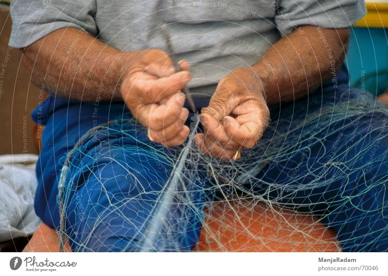 fisher Malta Marsaxlokk Fisherman Man Work and employment Hand T-shirt Pants Exterior shot Net Needle