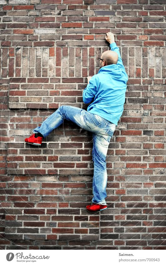 Human being Youth (Young adults) Man Blue City Red 18 - 30 years Adults Wall (building) Movement Sports Wall (barrier) Exceptional Facade Masculine Body