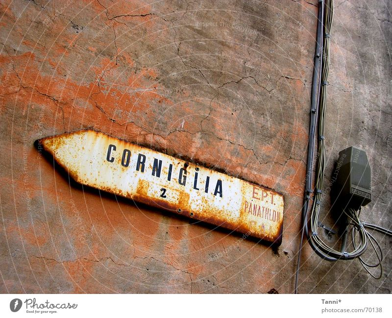 corniglia Street sign Alley Weathered Italy Wall (building) Wall (barrier) Direction Plaster Red Yellow Typography Signs and labeling Lanes & trails Rust Old