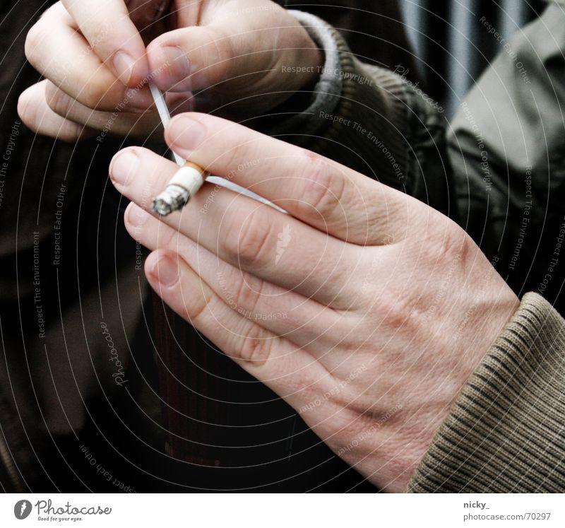 Man Hand Fingers Break Smoking Cigarette Unhealthy Men`s hand Filter-tipped cigarette Addictive behavior Harmful to health Health hazard