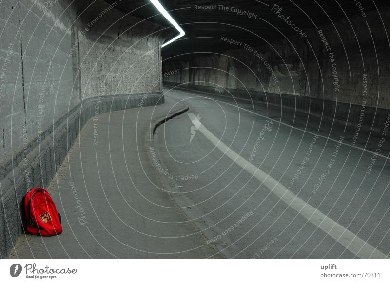 red pack Tunnel Backpack Dark Gray Gloomy Light Lamp Dust Asphalt Curbside Loneliness Red Hitchhike Mobile home Cold Decompose Transport Duisburg Steel Concrete