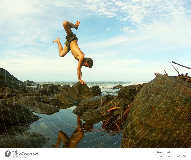 Youth (Young adults) Water Sky Ocean Blue Summer Joy Beach Vacation & Travel Clouds Sports Playing Movement Stone Contentment Coast
