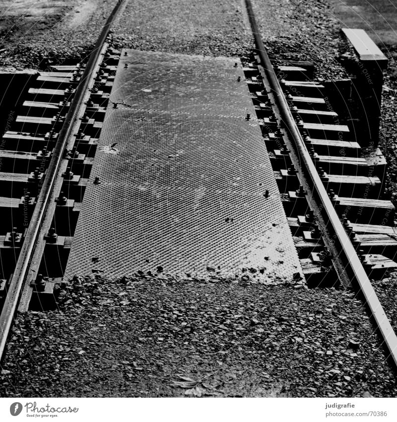 No deviation possible Railroad tracks Gravel Silhouette Steel Direction Black White Driving Wet Tin Covers (Construction) Regulation Lanes & trails Bridge Stone