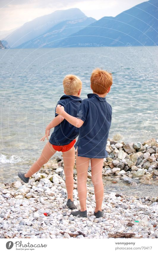 beach games Lake Waves Lake Garda Italy Dolomites Vacation & Travel Brother Family & Relations Ocean Beach Playing Boy (child) Red Child Fog Friendship Clouds