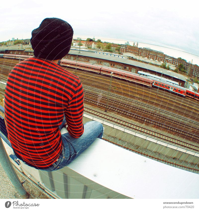 Man Dream Think Railroad Sit Roof Railroad tracks Cap Guy Train station Punk Striped Parking level Rock'n'Roll Reddish black