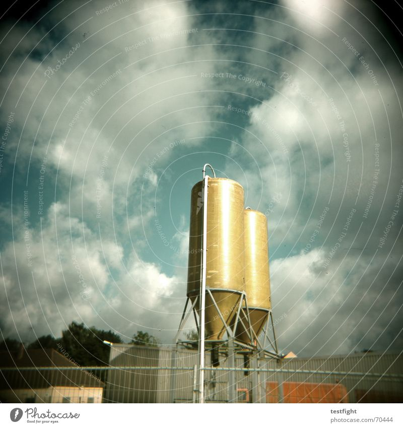 once, twice, very nice Silo Clouds Green Building Bad weather Holga Sky green green grass Sun Industrial Photography Gold cloudy