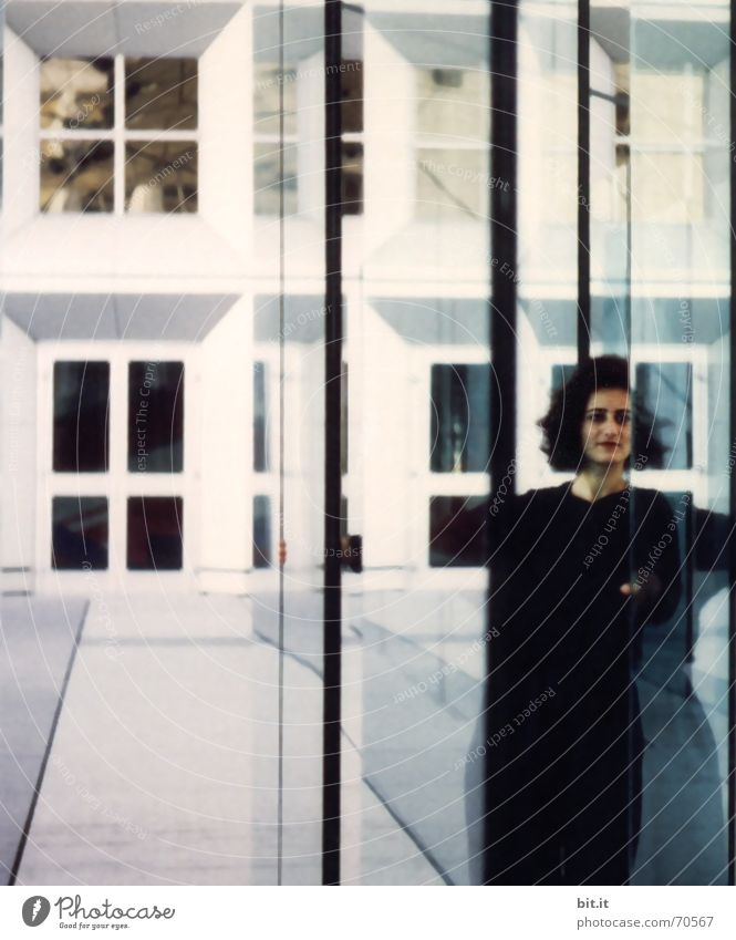 Woman Human being White Black Adults Wall (building) Building Wall (barrier) Line Glass Facade Perspective Transparent Identity Light Mirror image
