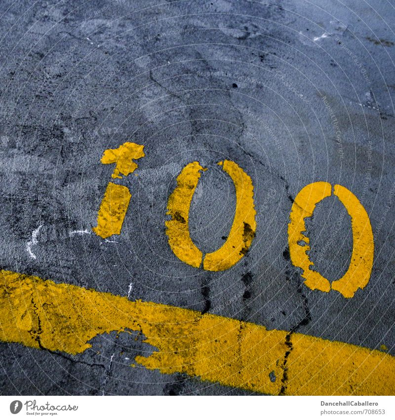 one hundred *100 :-) Traffic infrastructure Street Parking lot Underground garage Stone Concrete Sign Digits and numbers Signs and labeling Line Stripe Yellow