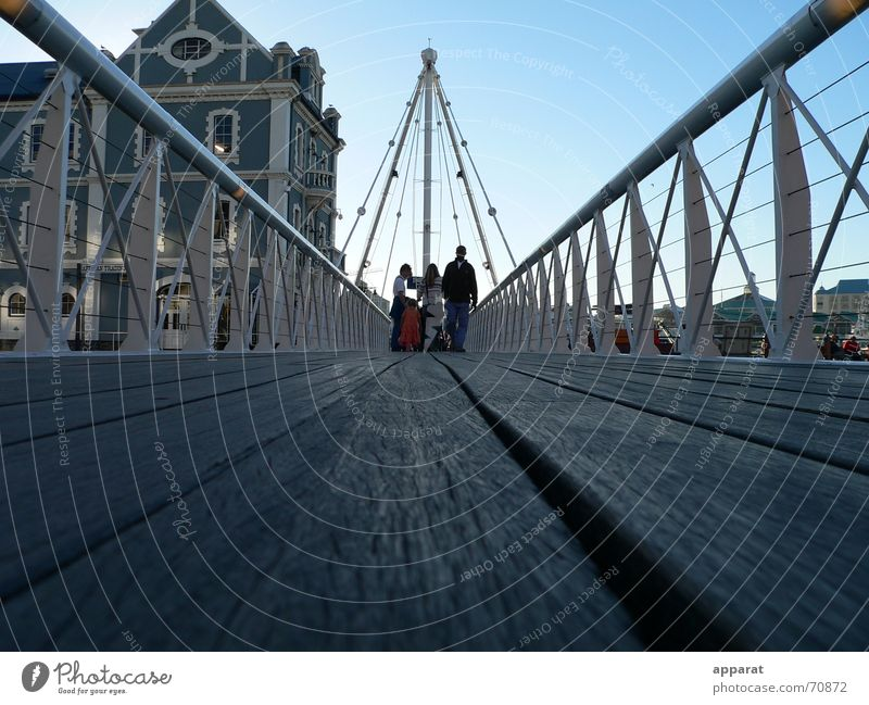 Human being City House (Residential Structure) Group Tourism Bridge Floor covering Harbour Africa Handrail Bridge railing Blue sky Wire cable South Africa