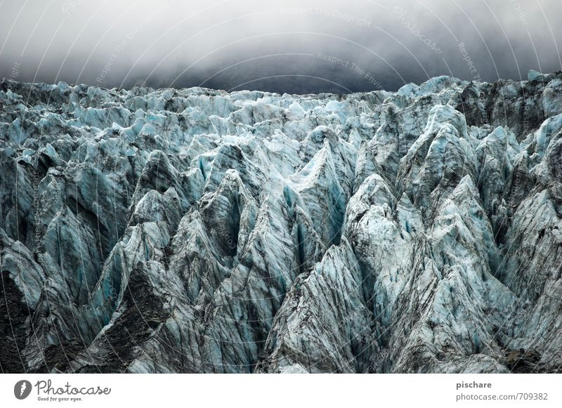 on the rocks Nature Landscape Clouds Ice Frost Alps Mountain Snowcapped peak Glacier Exceptional Dark Sharp-edged Cold Blue Adventure Fox Glacier New Zealand