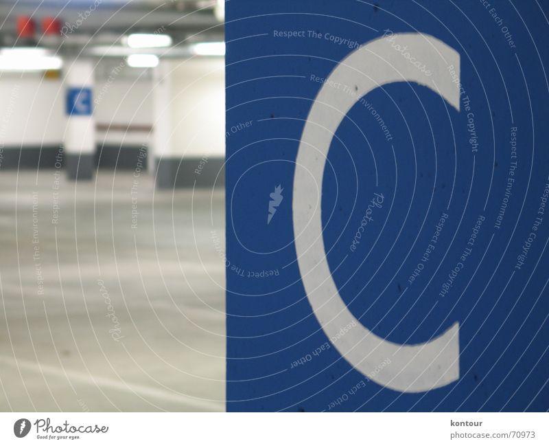 """Deck C Parking level Column Deep Typography White Blur Empty Underground Blue letter """"""""c"""""""""""