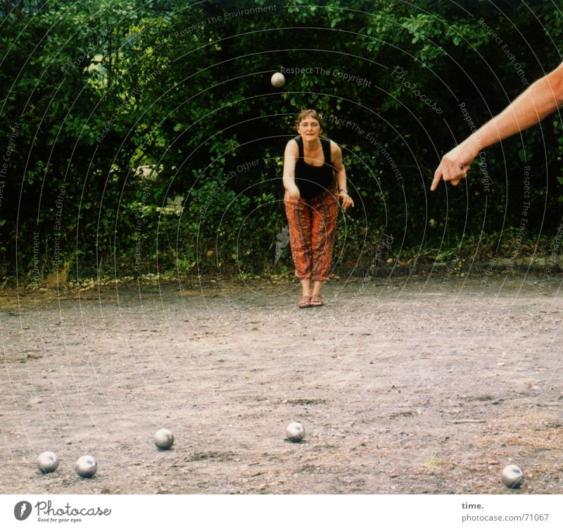 know-it-all Playing Boules Feminine Woman Adults 1 Human being 2 Tree Places Sphere Stand Willpower Brave Determination Caution Serene Life Curiosity Movement