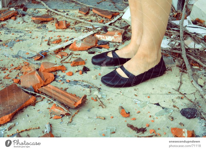 flogged Roofing tile Building rubble Shard Broken Footwear Lady Stand Shank's mare Black Brick Trash Chaos Muddled Destruction destroyed decay shoes legs feet