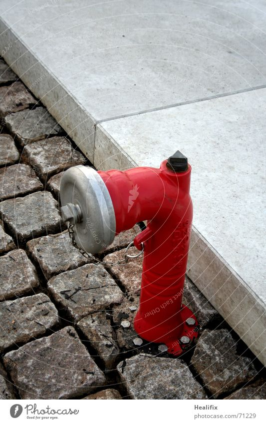 Water Red Gray Stone Metal Concrete Safety Protection Sidewalk Cobblestones Paving stone Curbside Object photography Fire prevention Fire hydrant