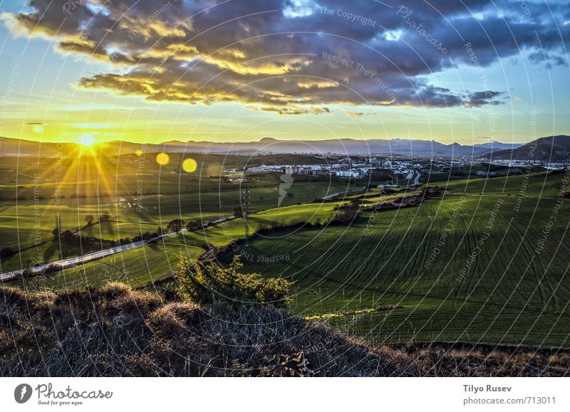 Beautiful sunset Nature Landscape Sky Clouds Meadow Town Natural Blue Yellow Green Sunset star Glow shine Ray Pamplona over fields Valley Spain Europe Navarra