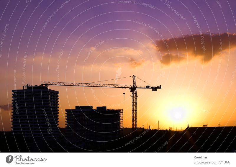 The Sun goes down Sunset Construction crane Crane Moody Evening sun Twilight Construction site High-rise Building The Ruhr Clouds Weather Beautiful Earth