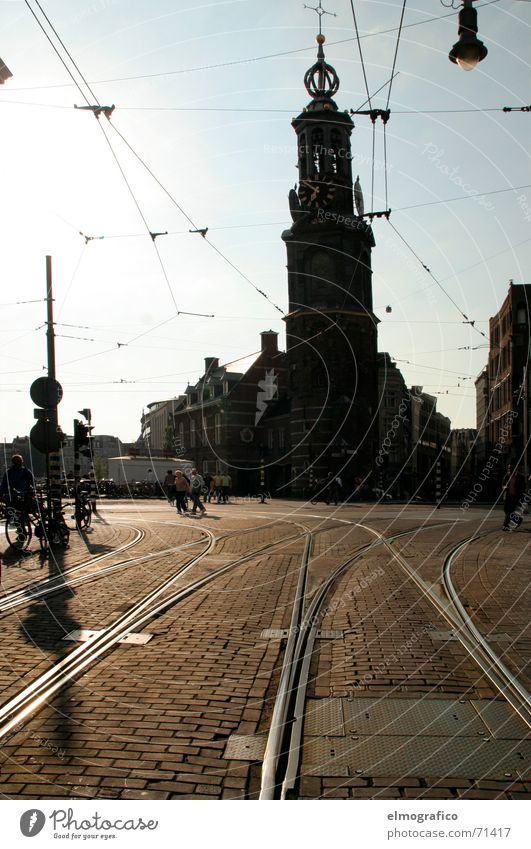 7before 7 Places Railroad tracks Tram Overhead line Light Back-light Dark Town Amsterdam Netherlands Summer evening Religion and faith Silhouette Sun Bright