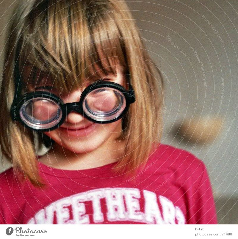 Little girl with pony wearing glasses / horn-rimmed glasses with high dioptres 3 - 8 years portrait Face of a child Childs upper body Blonde Bangs Eyeglasses