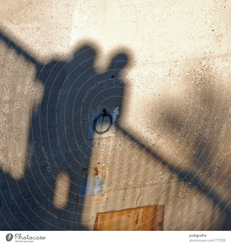 shadow 2 Together Wall (building) Wall (barrier) Concrete Light Shadow Human being Couple Handrail Line Circle Metal Rust Sun In pairs