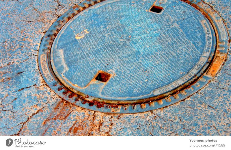 blue Contrast Water ditch Gully Broken Effluent Drainage system Round Crack & Rip & Tear Scrap metal Sewer Ancient Pavement Rust Asphalt Derelict Redevelop