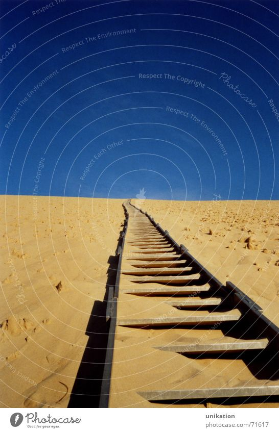 Sky Blue Yellow Above Sand Tall Railroad Stairs Railroad tracks France Upward Ascending Surrealism Go up