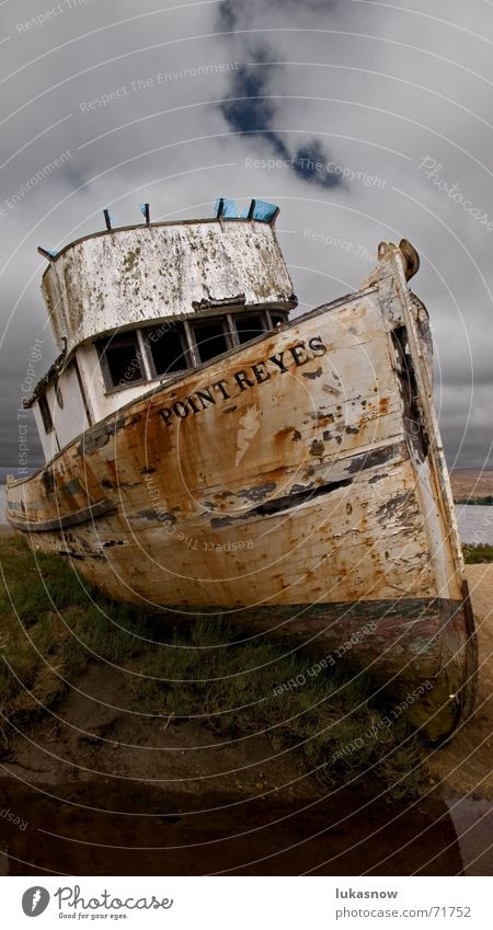 With the cutter over the field Fishing boat Field Dark Stranded Old Decline Watercraft Beach Derelict Wreck Thunder and lightning