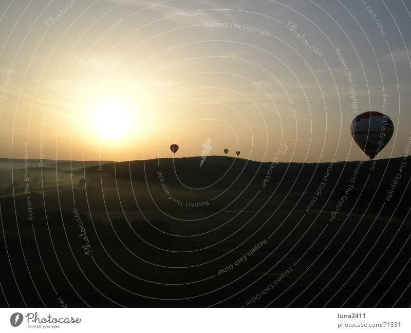 Balloon flight in the morning 1 Driving Sunrise Fog Ground fog Fog bank Light Back-light Stairs Landscape Sky Floor covering Hot Air Balloon