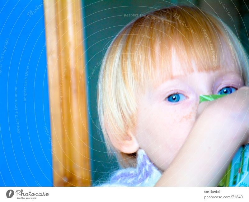 Eva Girl Child Juice drinking kitchen blue eyes contrast