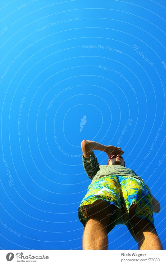 Where are we going to Hawaii? Vantage point Looking Pants Worm's-eye view Sky Human being Legs Arm Blue Wind