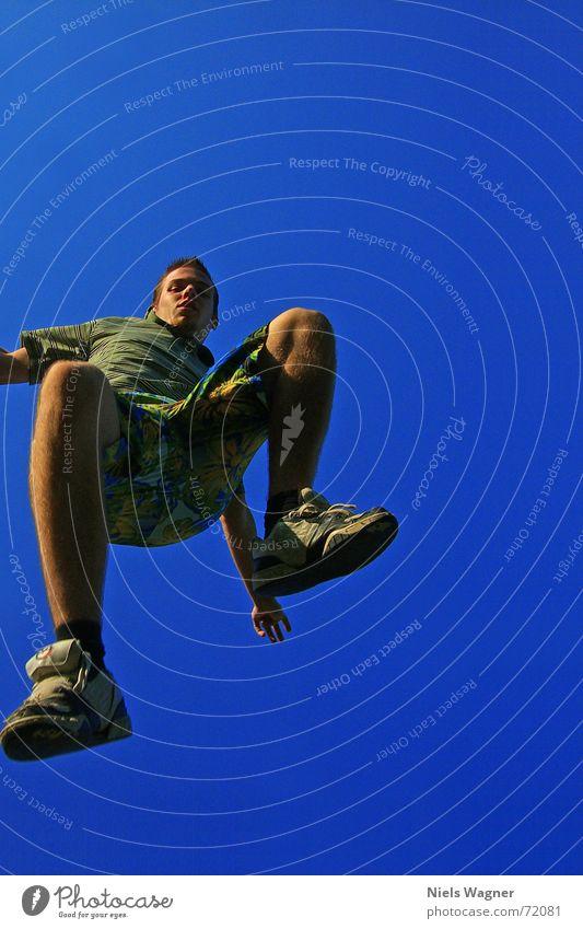 On the way to Hawaii Vantage point Jump Pants Worm's-eye view Footwear Air Sky Human being Legs Arm Blue Wind