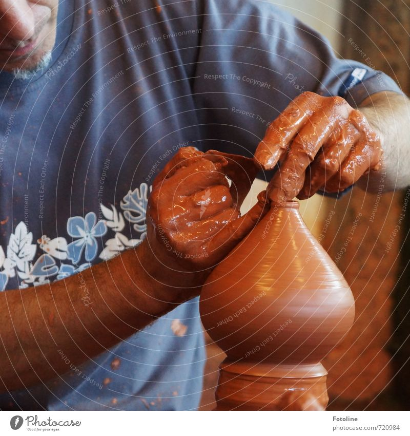 craftsmanship Human being Masculine Man Adults Nose Mouth Hand Fingers Blue Brown Pottery Do pottery Clay Colour photo Multicoloured Day Light