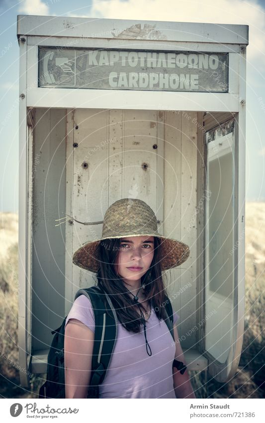Tourist in old telephone booth Lifestyle Vacation & Travel Tourism Summer vacation Human being Feminine Youth (Young adults) 1 13 - 18 years Child Greece Hat