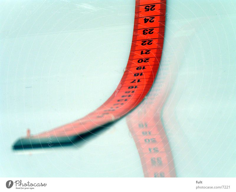 tape measure Tape measure Red Style Reflection Things White Digits and numbers Macro (Extreme close-up) Lie End Beginning Close-up Numbers