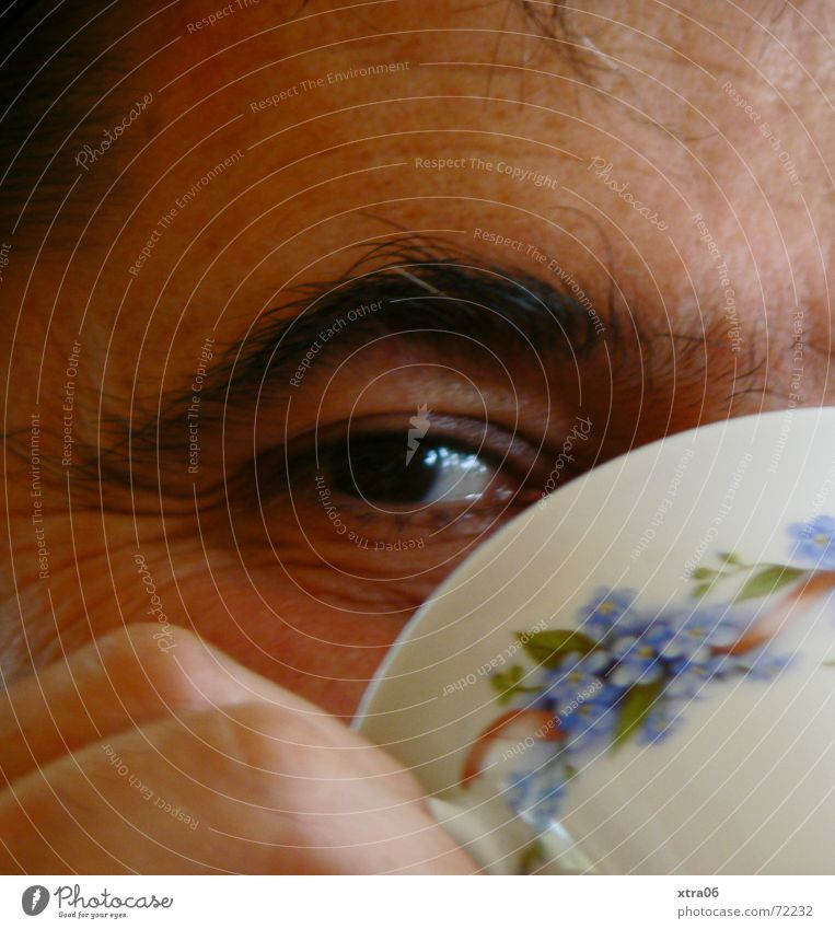 look me in the eye Eyebrow Man Cup Tea cup Lie (Untruth) Provocative Laugh lines Fingers Interior shot Drinking Coffee cup Flowery pattern Hand Eyes Human being