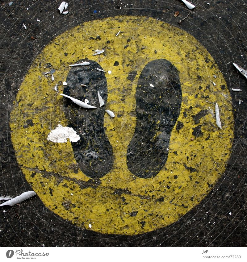 stay here Footprint Footwear Yellow Asphalt Tar Stand Going Stop Warning sign Black Sign Signs and labeling Floor covering Dirty