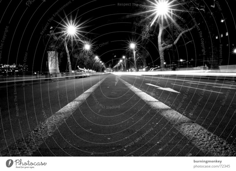 right in the middle Worm's-eye view Lantern Lamp Light Long exposure Night Driving Black & white photo Street car movement Dynamics road moving