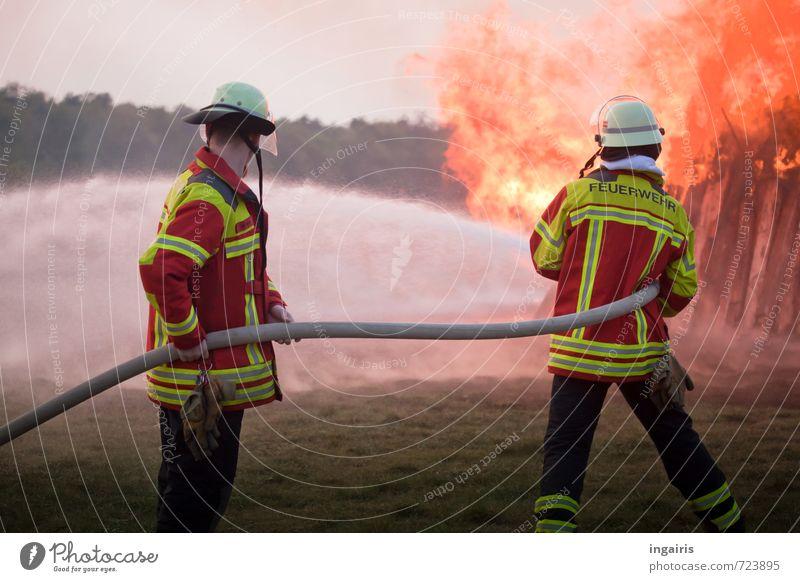 Extinguish fire Professional training Fireman Workplace Fire department Human being 2 Environment Sky wood Smoke Fight Illuminate Hot Yellow Orange Red