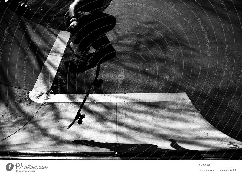 shove it sw Skateboarding Ramp Halfpipe Park Trick Stunt Jump Style Lifestyle Air Parking level street Shadow Sun Black & white photo Trick jump