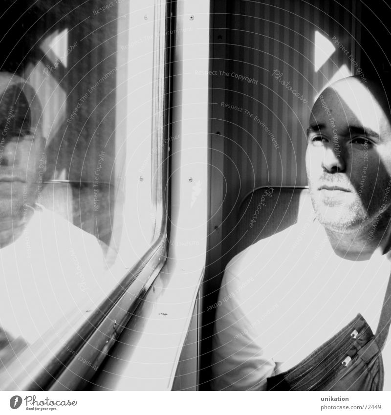 train travel Railroad Commuter trains Reflection Window Window frame Mirror image Man Calm Light Black White Sit view outside Frame framed Wait hardy Shadow