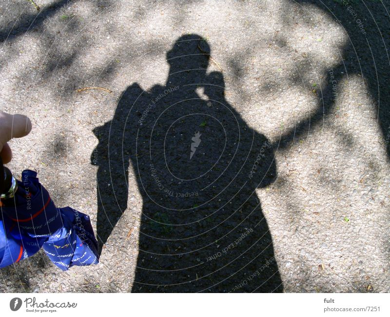 shadow man Man Umbrella Style Human being Tar Posture Photographic technology Shadow Blue Floor covering Nature Lanes & trails Structures and shapes