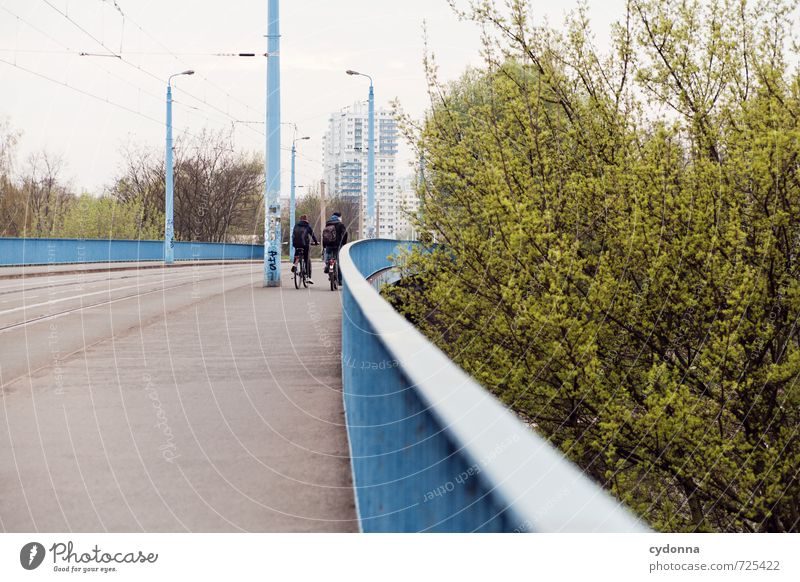 Human being Man City Landscape Adults Environment Life Street Movement Lanes & trails Leisure and hobbies Together City life Transport High-rise Bicycle