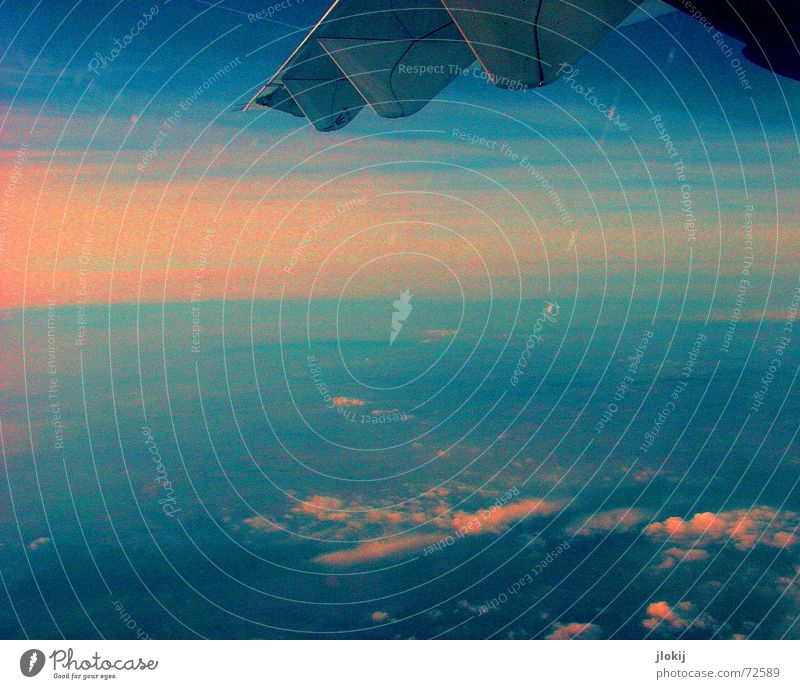 Sky Blue Clouds Airplane Flying Wing Sunrise View from a window Window seat